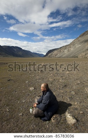 Relaxing hiker in arctic tundra, Greenland.