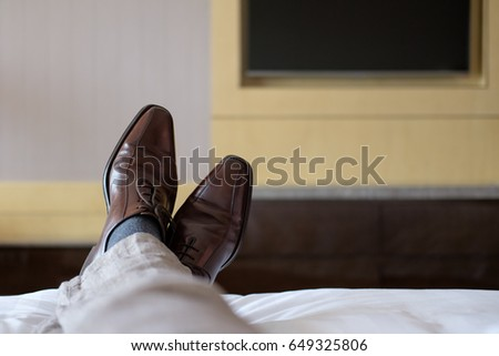Relaxing in Hotel Room during business trip. #649325806