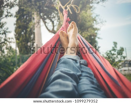 relaxing in the hammock, nude feet close up, spring day