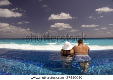 relaxing in the pool - stock photo
