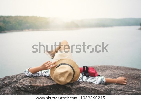 Relaxing moment Asian girl backpacker in nature ,enjoying time on holiday concept ,color of vintage tone selective and soft focus #1089660215