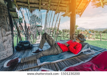 Relaxing moments, Asian relaxing outdoor on the lake in sunset. Relax time on holiday concept travel.