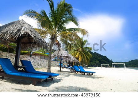 Relaxing on beach. Deck chairs on Teluk Chempedak, Malaysia.