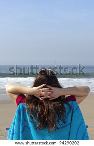 Relaxing on beach, young woman relaxing at the beach, copy space