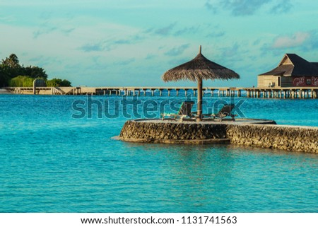 Relaxing place with nice seaview in a resort in Maldives in the middle of Indian Ocean. Tourists are visiting Maldives more and more nowadays for its paradise environment. #1131741563