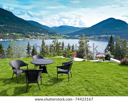 Relaxing Point in the norwegian fjords - stock photo