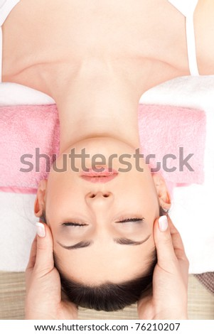 relaxing spa massage of head at spa salon