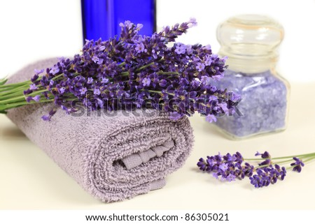 Relaxing spa resort composition - towels, lavender flower, bottle with salt.