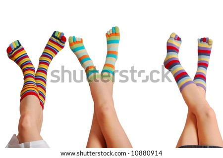 Relaxing three kids, many colors of socks, isolated on white background