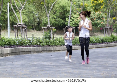 Relaxing time on summer,Daughter and mother jogging at park #661975195
