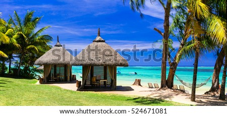 Stock Photo Relaxing tropical holidays with bungalows and hammock on white beach