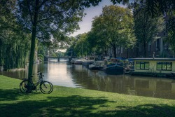 Relaxing view of a park with bikes near Nieuwe Keizersgracht canal in Amsterdam.