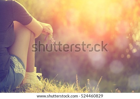 Relaxing woman at nature in sunset