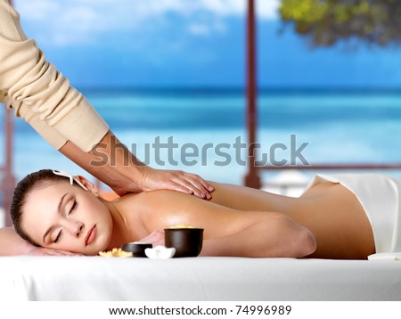 Relaxing woman in a resort having spa healthy massage - horizontal