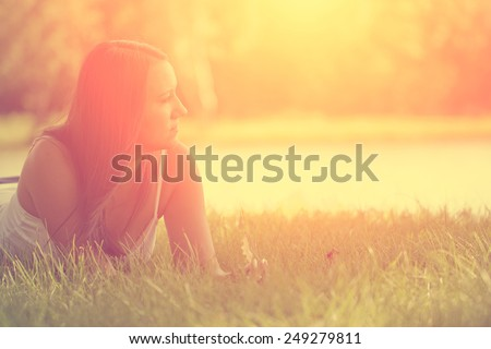 Relaxing woman on grass #249279811