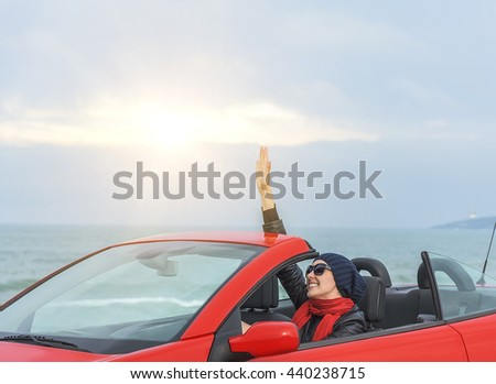 Relaxing woman on the beach in the car. Vacationor trip concept. #440238715