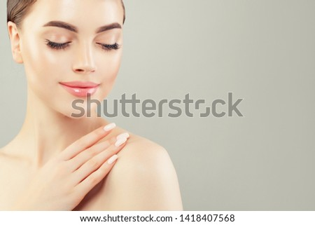 Relaxing woman with clear healthy skin on white background #1418407568