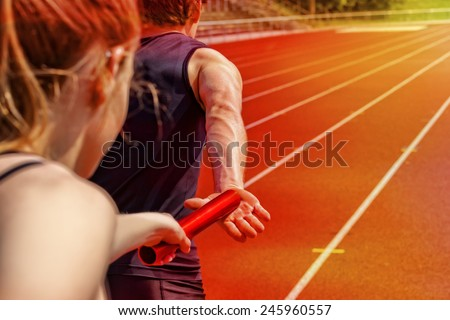 Relay race handing over from woman to man Foto d'archivio ©