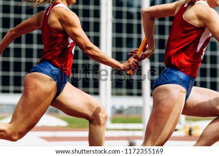 relay race passing of baton women team runners Foto d'archivio ©