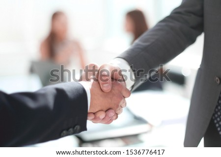 reliable handshake of business partners in the office