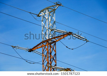Reliance of high voltage power lines and blue sky.