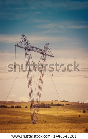 Reliance power lines at sunset in the steppe landscape hills