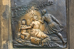 Relief below the statue of St. John of Nepomuk on Charles Bridge in Prague, Czech Republic
