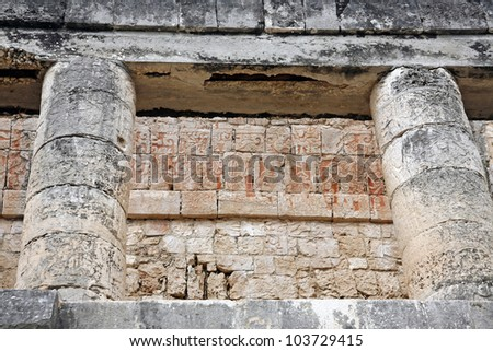 relief details of temple ruins in great ball court of Chichen Itza Mexico