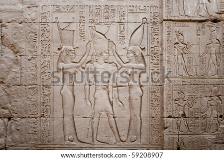 Relief showing the coronation of the pharaoh Ptolemy by the goddess nekhbet on the right and wadjet on the left.  Temple of Horus  (246-221 BC), Edfu on the Nile. Egypt.
