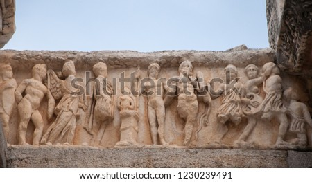 Relief statues on the frieze from Ephesus ancient city, Izmir, Turkey. The ancient city is listed as a UNESCO World Heritage Site.