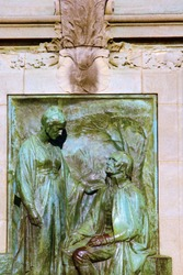 Reliefs, symbols, statues, architectural decorations of ancient buildings. Bronze high relief of the 19th century. Paris