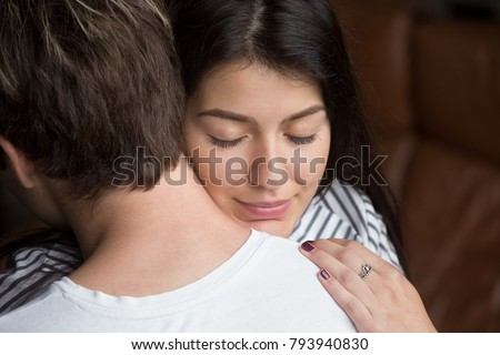 Relieved happy woman hugging man, grateful wife embracing caring loving husband thanking for help support, apology and forgiveness, empathy understanding in relationships concept, close up headshot