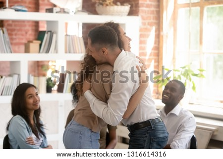Relieved man and woman hugging giving psychological support empathy during group therapy session, friends people embracing comforting helping overcome problems addiction at psychotherapy counseling