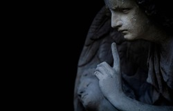 Religion and death concept. Ancient statue of an angel as symbol of end of life. Horizontal image.