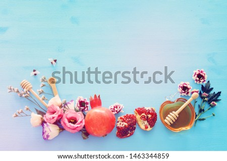 religion image of Rosh hashanah (jewish New Year holiday) concept. Traditional symbols over wooden blue background