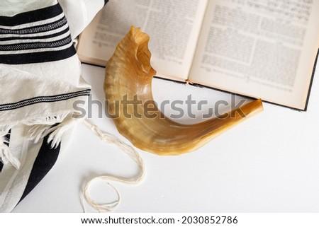 Religion image of Shofar (horn), Tallit (Prayer Shawl)  and Prayer book religious symbols. Rosh hashanah (jewish New Year holiday), Shabbat and Yom kippur concept.