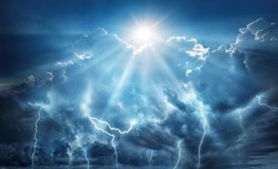 Religious and scientific apocalyptic background. Dark sky with lightning and dark clouds with the Sun that represents salvation and hope.
