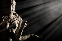 Religious artifact. Bronze statue of Hindu Goddess Lakshmi. Hinduism in close up. Museum quality exhibit against black background with copy space.