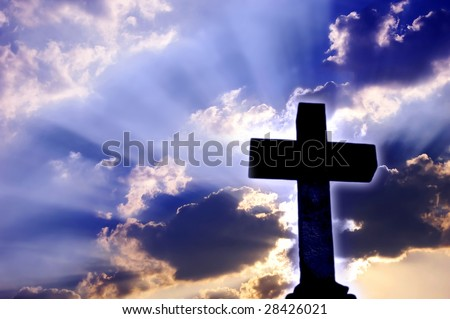 Religious Christian cross over beautiful sky with rays of light