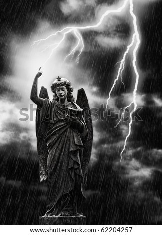Religious concept image, lightning striking a statue of the angel Gabriel
