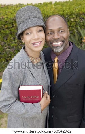 Religious Couple with Bible in garden, portrait, high angle view