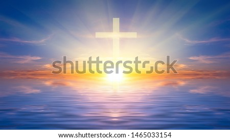 Religious cross against the sunset over the sea, symbolizing the hope of salvation and forgiveness. Religious composition #1465033154