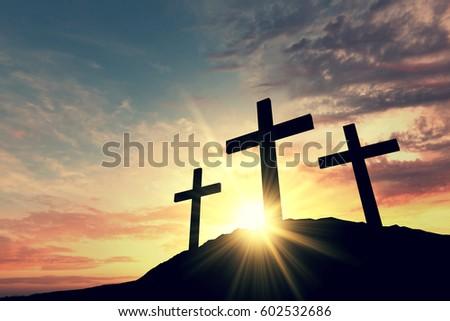 Religious cross silhouette against a bight sunrise sky #602532686
