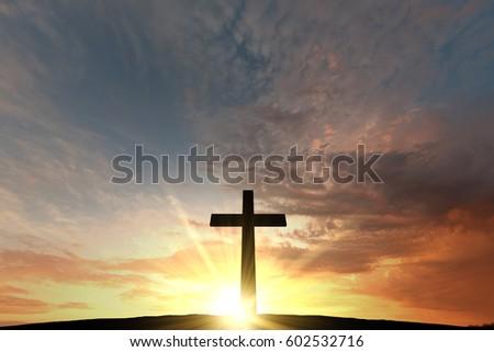 Religious cross silhouette against a bight sunrise sky #602532716