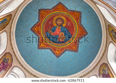 Religious fresco of Jesus Christ painted on ceiling of orthodox church of Saint Martyr Haralambie in Chisinau city, Moldova