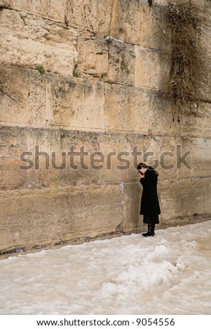 Religious girl, who prays in western wall. - stock photo