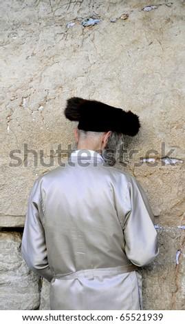 Religious Jew Praying at the Wailing Wall Jerusalem ,  Israel. - stock photo