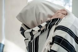 Religious jew prays in a tallit. Jewish prayer