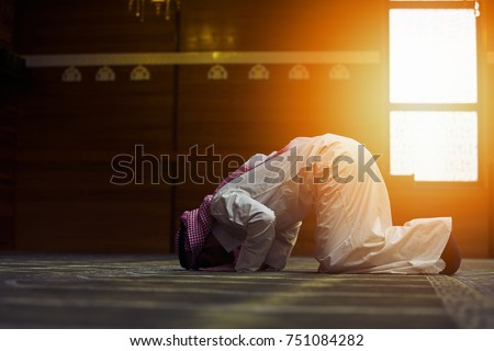 Religious muslim man praying inside the mosque