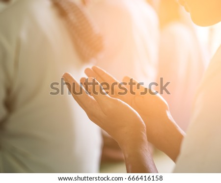 Religious muslim man praying inside the mosque / soft focus picture / Vintage concept